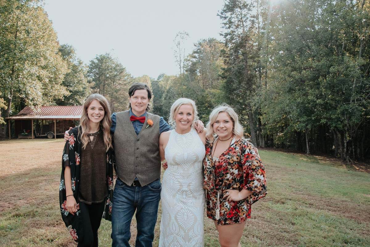 Staff members Lindsey and Delaney with couple